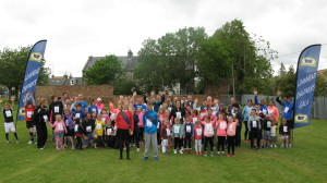 96 runners of all ages took part in the Gala Fun Run on Sunday 21 June 2015. Our photo shows the runners assembled at the start line in the Memorial Park.The winners in the various categories.were:-   Nursery Boys - Rudi Campbell Nursery Girls - Lucy Foxwell Primary School Boys - Declan Roose Primary School Girls - Chelsea Brough Secondary School Boys - Rudi Hunter (first runner home in all categories) Secondary School Girls - Mirren Gray Adult Males - Paul Anderson Adult Females - Hayley Sanders Over 60's - John Veitch   Everyone who completed the course received a medal.