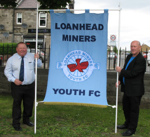 A new feature in the procession at this year's Children's Day will be a banner carried by the members of Loanhead Miners' Youth FC. Gala Chairman Ross Perfect and Youth FC Secretary Peter Frame are seen here with the new banner.